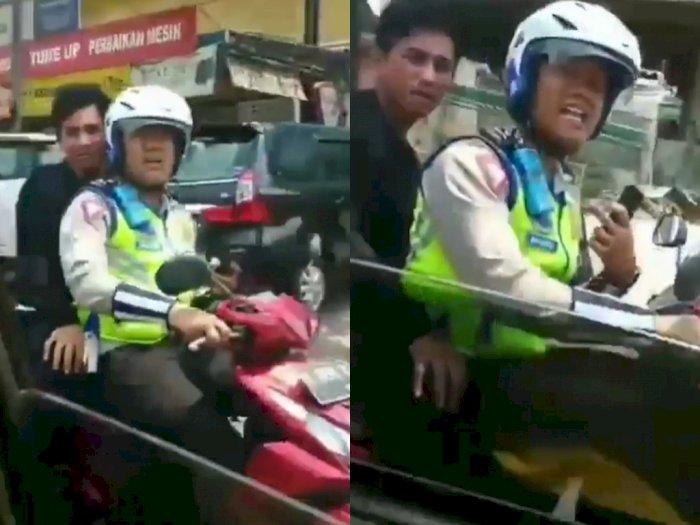 Polisi Ini Kena Teguran Karena Bonceng Pria Nggak Pakai Helm & Main HP