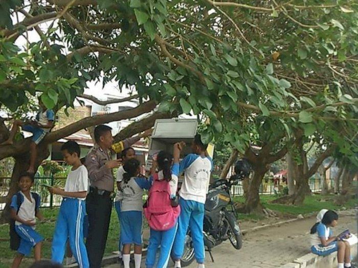 Polisi Ini Jalankan Perpustakaan Keliling ke Sekolah-sekolah