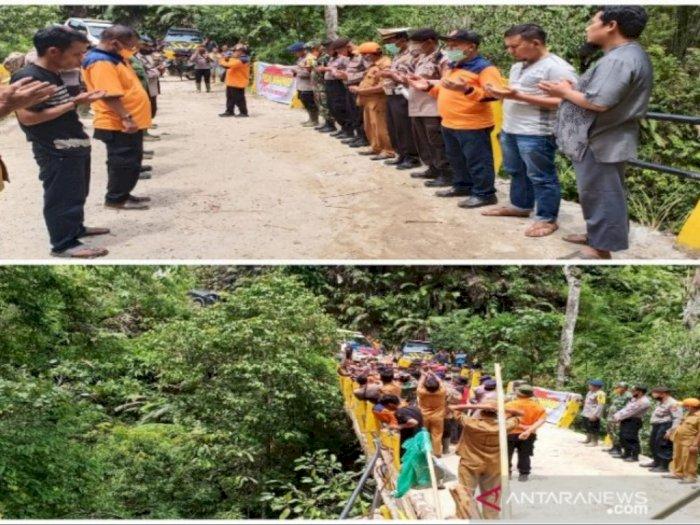 Keluarga Ikhlas Pencarian Sopir Truk yang Jatuh ke Sungai Aek Bilah Dihentikan