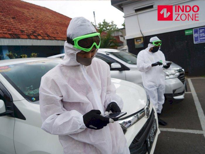 FOTO: Cegah Virus Corona, Pengemudi Taksi Online Gunakan APD