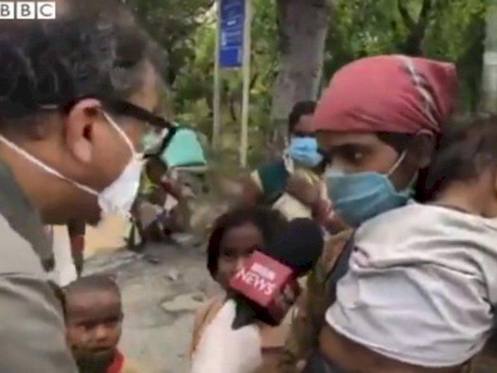 Momen Haru Seorang Jurnalis Berikan Sepatunya untuk Pemudik yang Jalan Kaki
