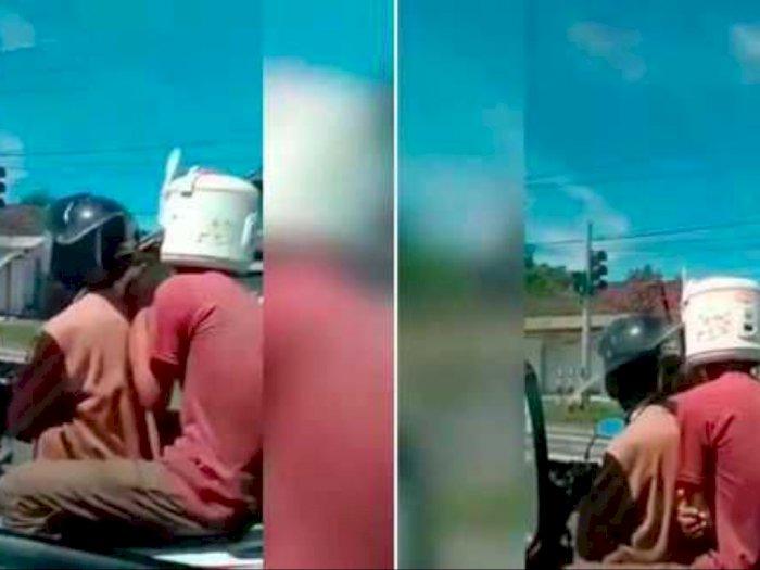 Tidak Ada Helm, Pria Ini Malah Pakai Rice Cooker Untuk Dijadikan Helm
