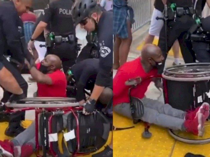Viral Polisi AS dan Pendemo Ricuh, Lelaki Difabel Terjungkal dan Kursi Rodanya Direbut