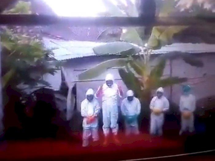 Video: Pemakaman Jenazah Covid-19 oleh Petugas Berpakaian Hazmat Ini Dinilai Tak Lazim