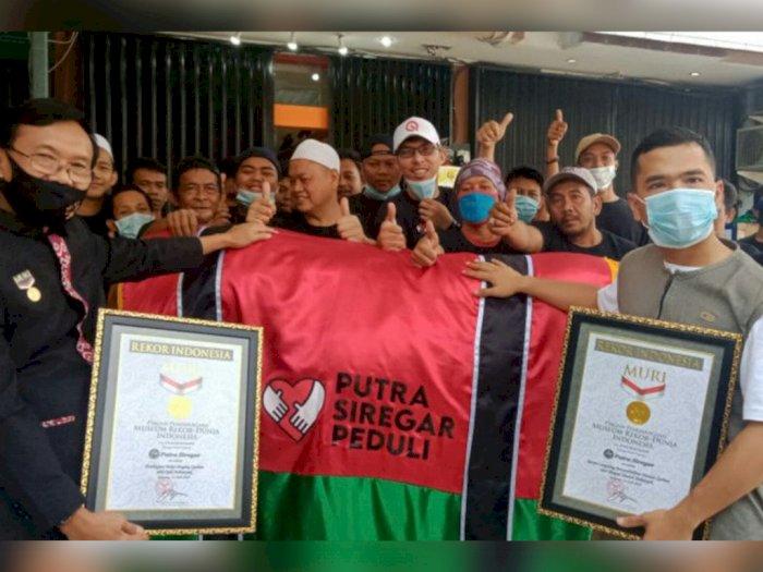 Hari Raya Idul Adha, Bos PS Store Putra Siregar Raih Rekor MURI dari Kurban 410 Hewan