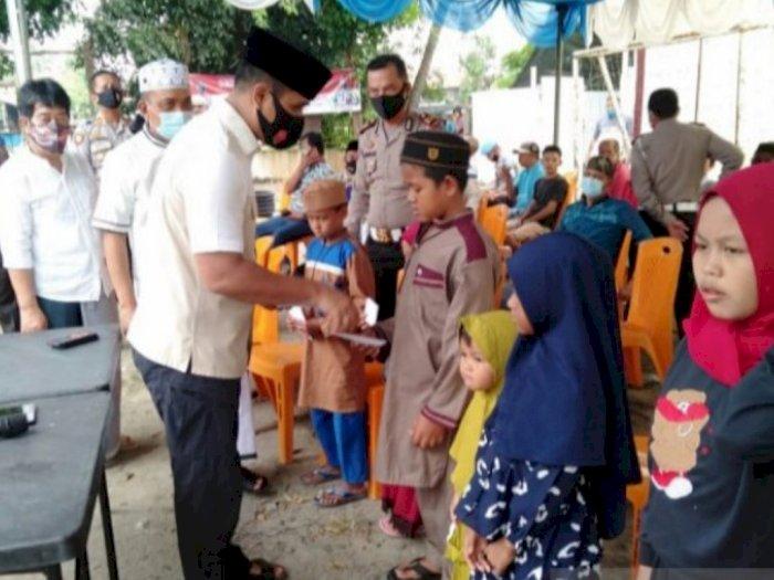 Polres Tanjung Balai Sembelih 7 Sapi dan Santuni Anak Yatim