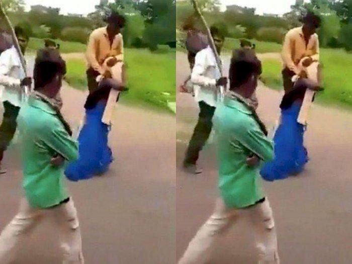 Dituduh Selingkuh, Wanita Ini Dihukum Keliling Kampung Sambil Gendong Suami & Dilempar Ban