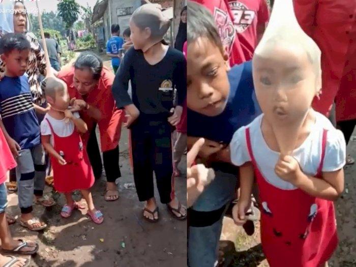 Viral Video Bocah Lomba 17-an Tiup Lilin Pakai Stoking, Aksinya Bikin Warganet Ngakak!