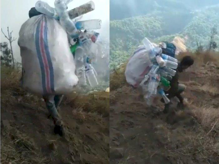 Salut! Pria ini Kumpulkan Sampah Sisa dari Para Pendaki Lain di Gunung