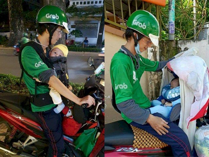 Sedih! Driver Ojol ini Harus Bawa Anaknya yang Masih Berumur 8 Bulan Saat Bekerja