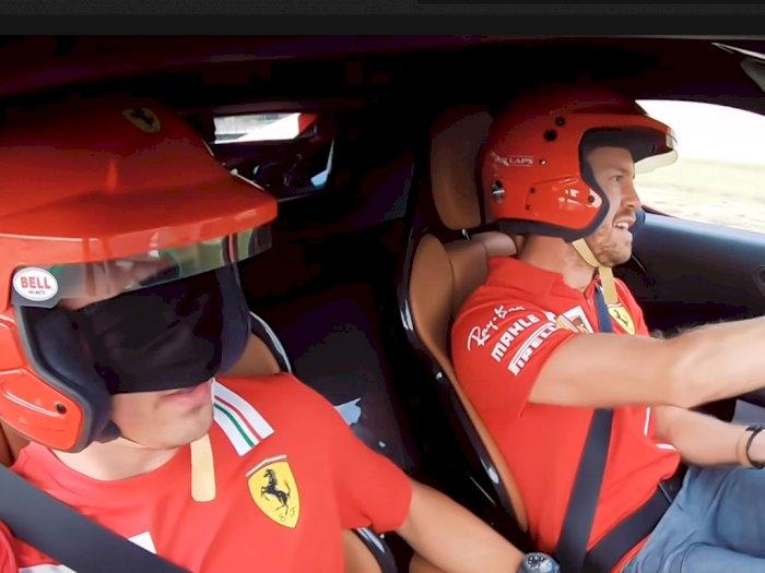 Melihat Vettel dan Leclerc Saat Berada di Mobil Ferrari dengan Mata Tertutup