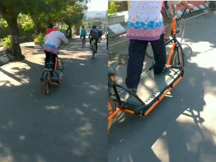 Video Viral! Pria ini Kendarai Sepeda Tapi dengan Berjalan, Bikin Netizen Bingung