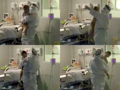 Mengharukan! Video Petugas Medis Coba Tenangkan Balita yang Diduga Terinfeksi COVID-19