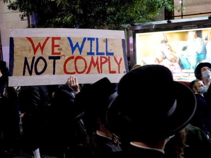 FOTO: Kelompok Ultra-Ortodoks Yahudi Memprotes Aturan Baru COVID-19 di New York