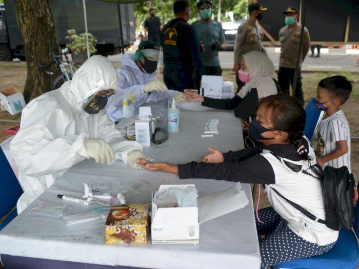 FOTO: TNI dan Polri Gelar Rapid Test Massal Cegah COVID-19