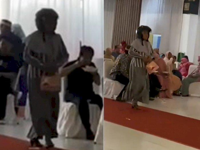 Viral Video Emak-emak Lupa Lepas Helm Saat ke Kondangan, Para Tamu Tertawa Ngakak