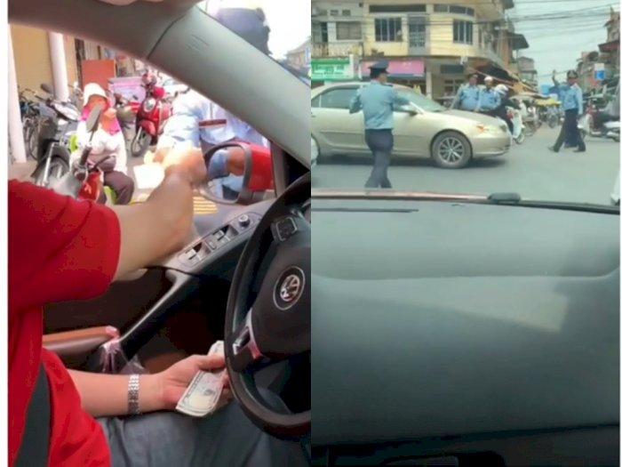Video Saat Polisi yang Terima Uang dari Pengemudi Mobil Saat Macet, Jalan Langsung Dibuka