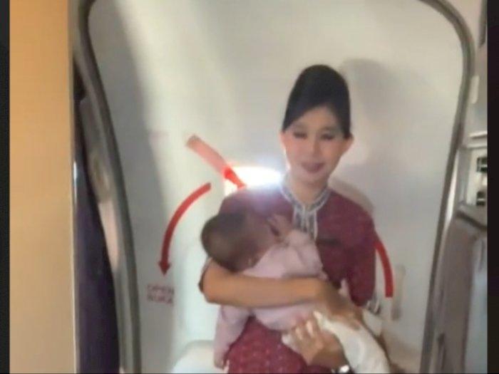 Viral Ditonton 11,2 Juta Kali, Pramugari Gendong Bayi di Kabin Pesawat Bikin Netizen Salut