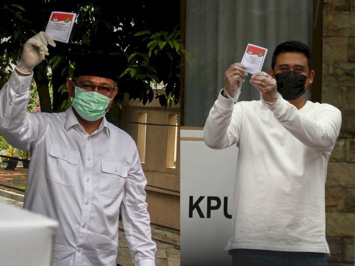 FOTO: Momen Saat 2 Calon Wali Kota Medan Gunakan Hak Pilihnya