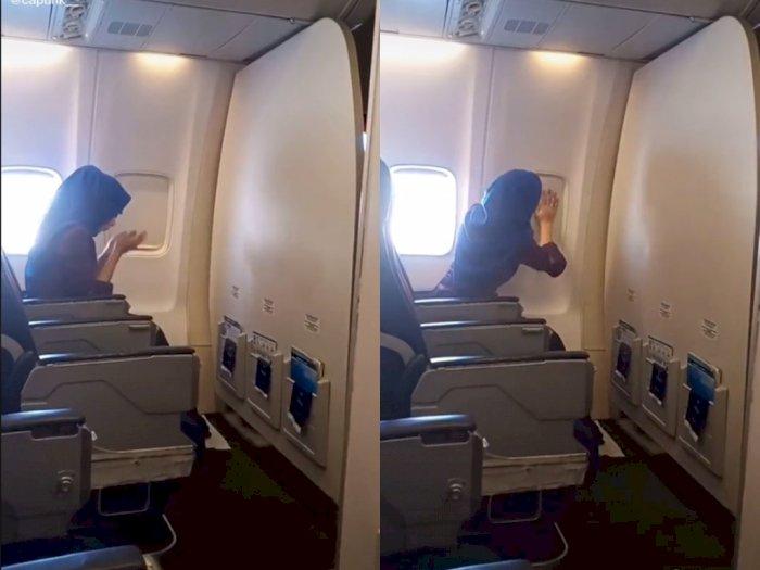 Salut! Meski Berada di Pesawat, Wanita ini Tetap Tunaikan Shalat dengan Tayamum