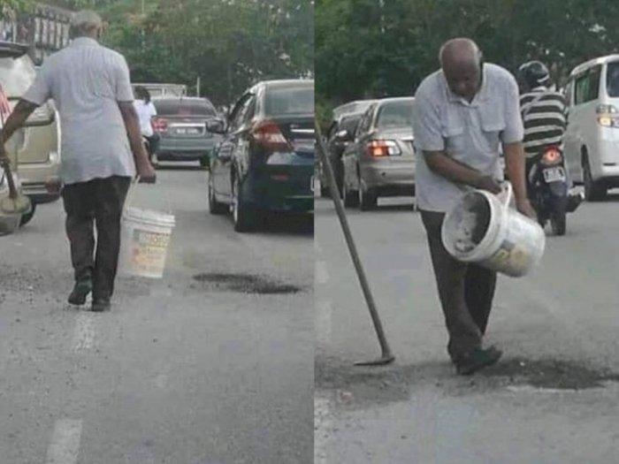Viral, Pria Lansia Ini Menutupi Lubang dengan Pasir Sendirian saat Jalanan Ramai