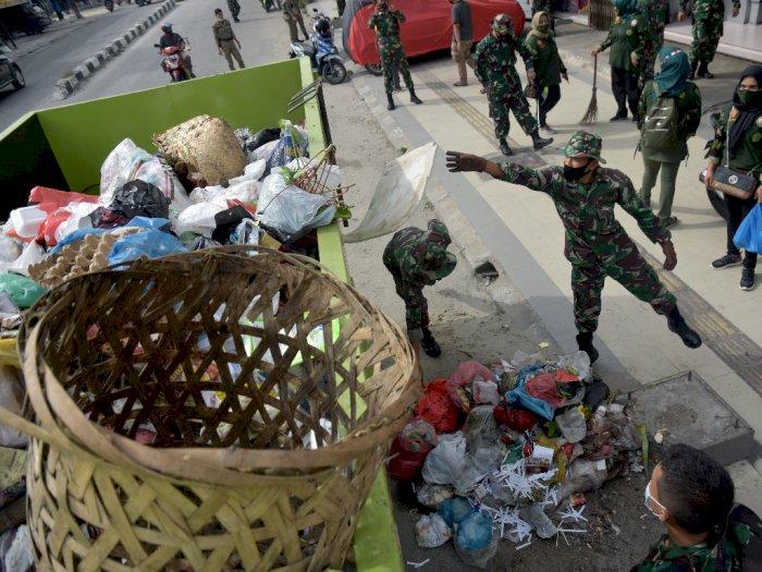FOTO: Aksi TNI Atasi Krisis Sampah Pekanbaru