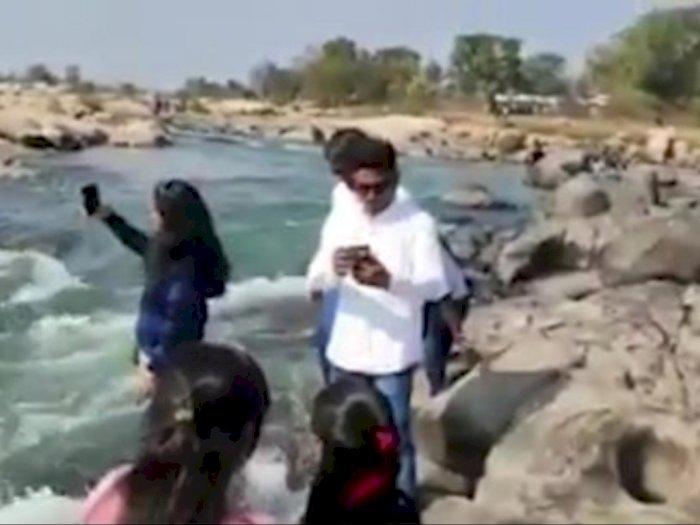 Seorang Gadis Meninggal Setelah Terlempar ke Sungai Oleh Turis yang Sedang Mengambil Foto