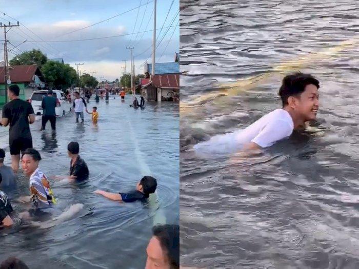 Banjir Dijadikan Seperti Tempat Wisata, Netizen: Ini Sebabnya Salju Gak Turun di Indonesia