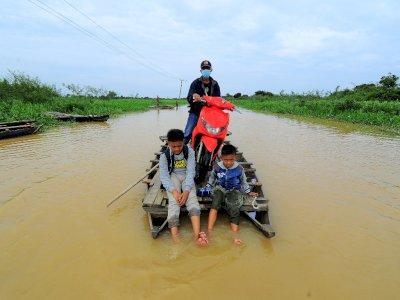 FOTO: Banjir Luapan Sungai Batanghari di Jambi