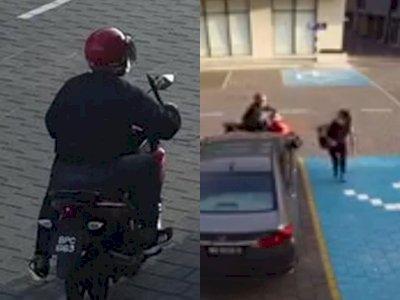 Detik-detik Pengendara Motor Mengejar dan Rampas Wanita yang Sendirian di Tempat Parkir