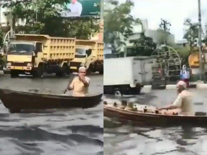 Kakek Ini Kayuh Jukung di Tengah Jalan yang Terendam Banjir, Tuai Pujian dari Netizen