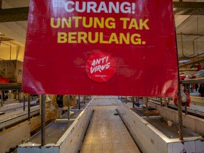 FOTO: Aksi Mogok Pedagang Daging di Pasar Senen
