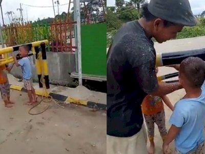 Dramatis! Momen Penyelamatan Bocah yang Menangis Histeris Tangannya Terjepit di Portal